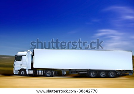 white semi-truck on road - stock photo