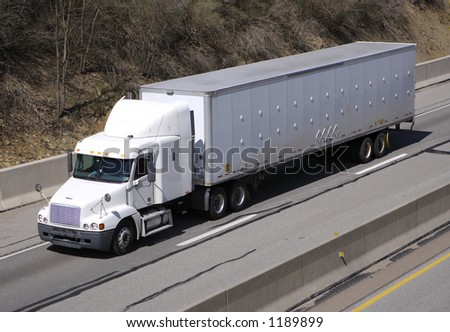 White Semi Truck on the Highway - stock photo