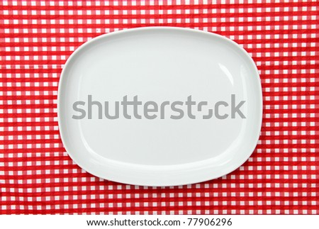 White Serving Platter Plate on red and white checkered background - stock photo