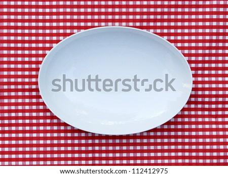 White Serving Platter Plate (oval dish) on red and white checkered background