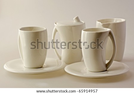 White set of cups for breakfast over white - stock photo