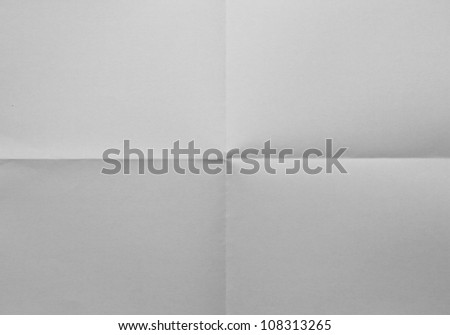 White sheet of paper folded in four - stock photo