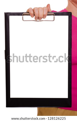 White sheet of paper on a clipboard with a female hand - stock photo