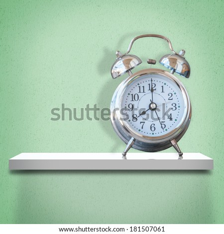 White shelf with alarm clock - stock photo