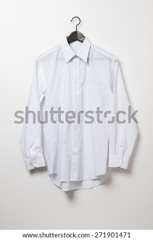 White shirt and hanger - stock photo