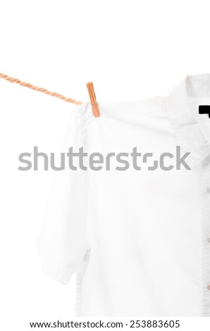 white shirt hanging on a rope clothesline isolated on white - stock photo