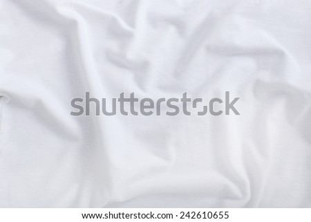 White shirt on a wooden table - stock photo