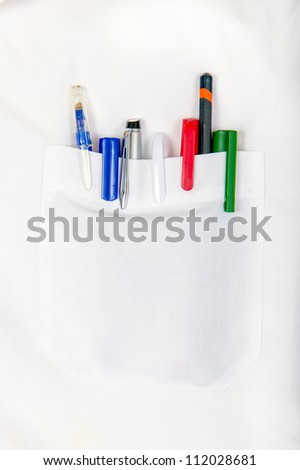 white shirt pocket with colored pens - stock photo