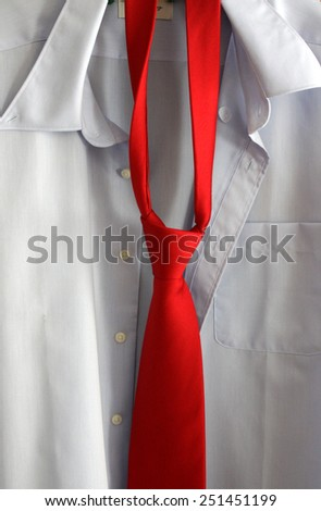 White shirt with red tie. relaxed - stock photo