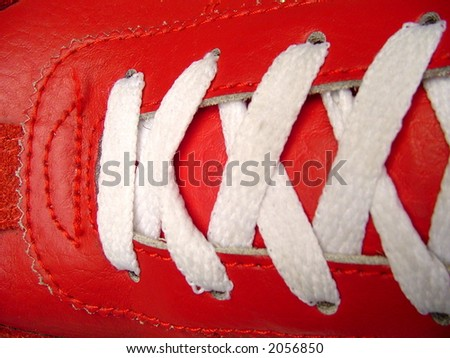 White shoe laces and red leather - stock photo