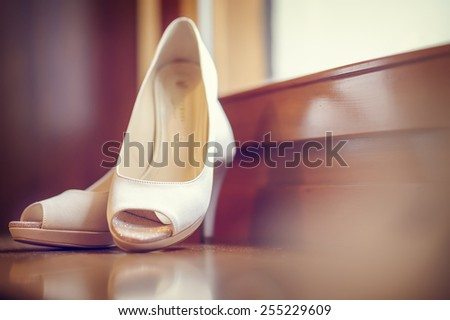 White shoe of the Bride . wedding theme background (cross processing effect) - stock photo