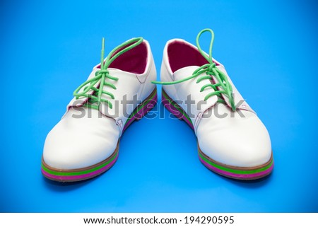 White shoes on a blue background  - stock photo