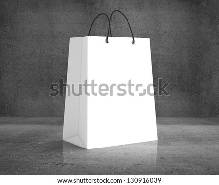 white shopping bag on a concrete background - stock photo