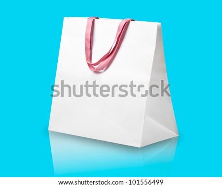 White shopping bag on light blue. - stock photo