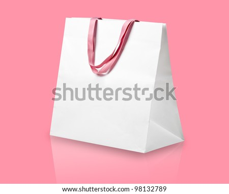 White shopping bag on pink. - stock photo