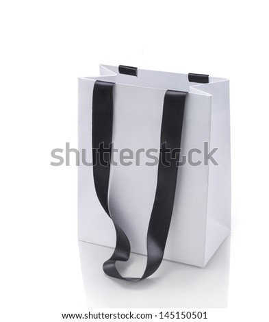 White shopping bag on white background and soft reflection. clipping path on bag. - stock photo