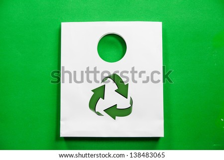 white shopping bag with recycle symbol on green background - stock photo