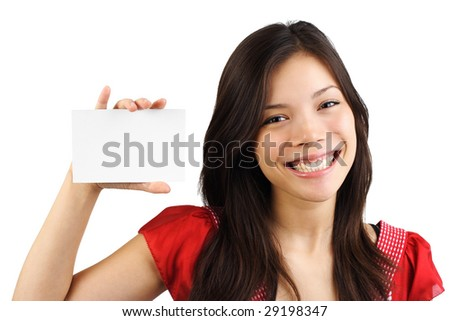 White sign or notecard. Smiling mixed caucasian / asian woman with a blank card. Isolated on white - stock photo
