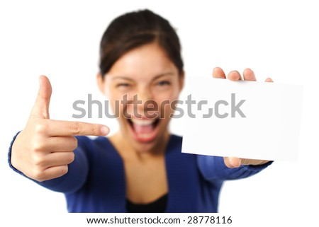 White sign or notecard. Very excited mixed caucasian / asian business woman pointing at blank card. Isolated on white. - stock photo