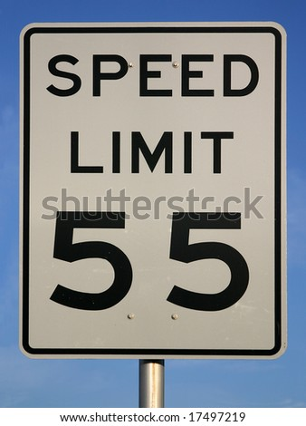"""White sign with """"speed limit 55"""" printed in black. Sign is shot against a blue sky. PHOTO ID: SpeedLimit5500015 - stock photo"""
