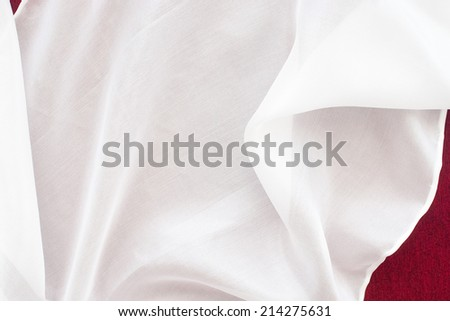 white silk on red background