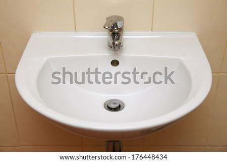 white sink and tap in the bathroom or public toilet c3 sink