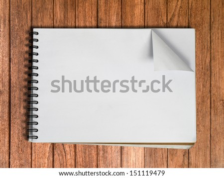 White sketch book one page on Wood table background - stock photo