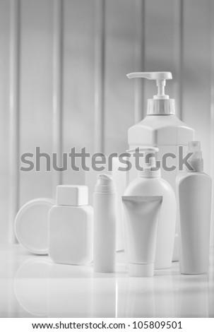 white skincae items on table - stock photo