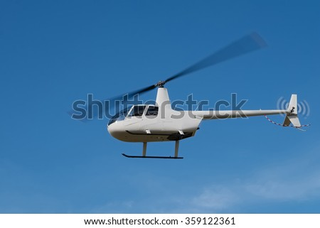 white small helicopter in the sky