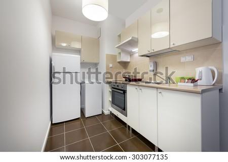 White, small kitchen interior design - stock photo