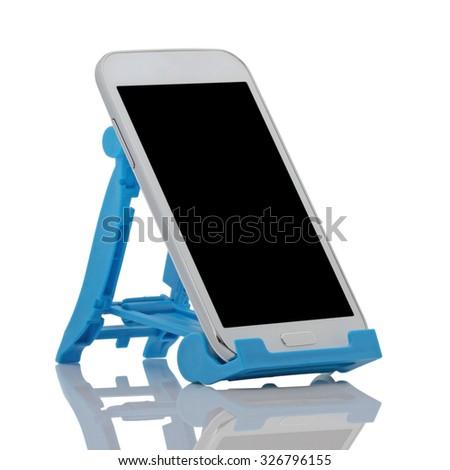 white smart phone on tripod isolated on white background - stock photo