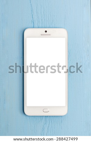 White smart phone with isolated screen on wooden desk. - stock photo