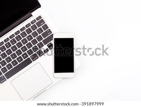 White smartphone and laptop. Can use for printing, website, presentation element.  - stock photo