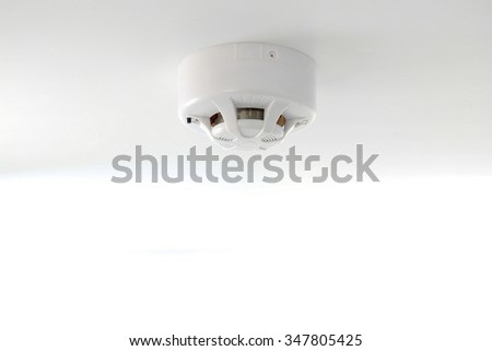 White smoke detector on ceiling - stock photo