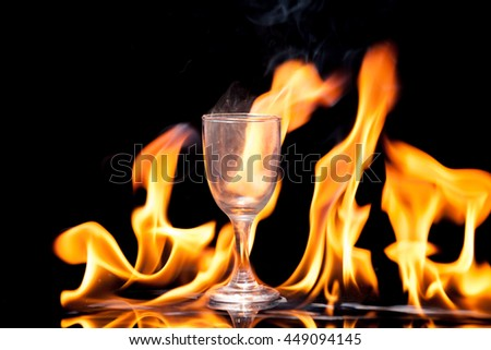 White smoke, glass, fire on black background.