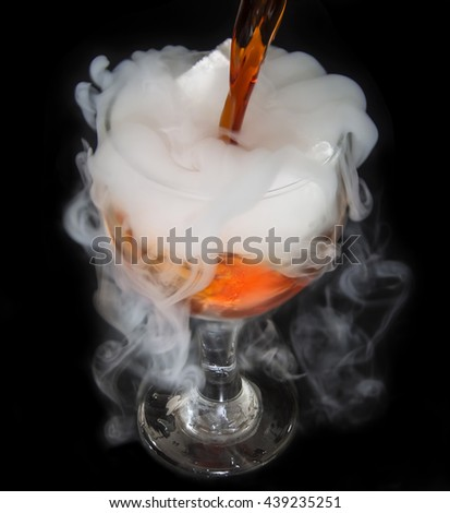 White smoke in glass with the effect of dry ice on dark  background