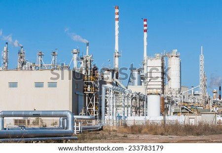 White smoke in the blue sky - stock photo