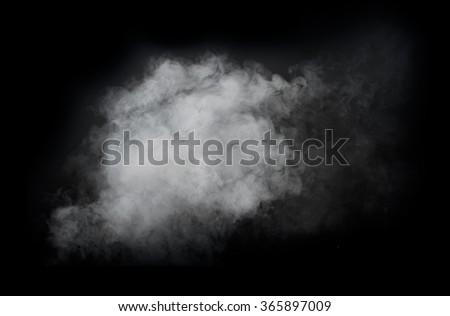 White smoke isolated on black background - stock photo
