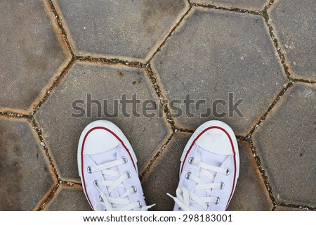 White Sneaker shoes standing on street. Top view. Vintage effect. - stock photo