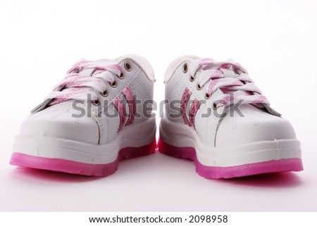 White sneakers with pink sole and stripes