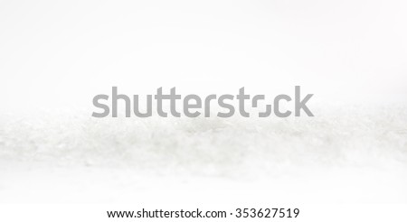 White Snow background while an awesome and atypical snow day. Studio. - stock photo