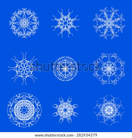 White Snow Flakes Isolated on Blue Winter Background - stock photo