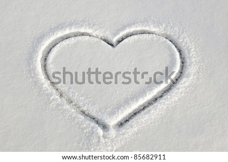 White snow with drown heart shape - stock photo
