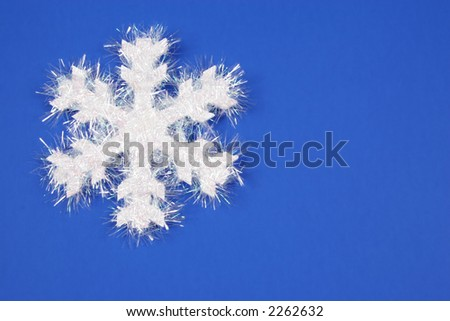 White Snowflake with blue Background