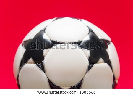 White soccer ball on a red background - stock photo