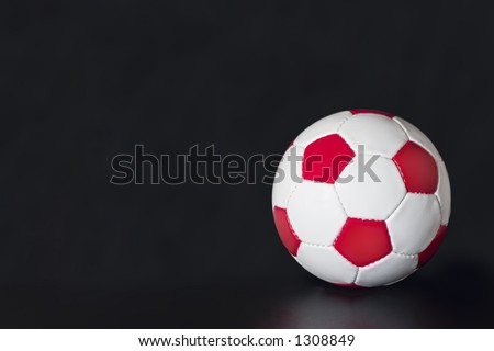 White Soccer Ball with red pentagons and white hexagons - stock photo