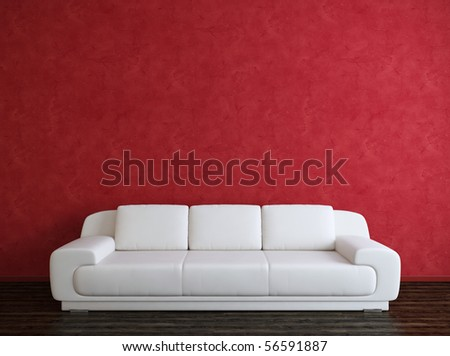 White sofa and red wall - stock photo
