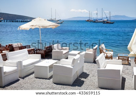 White sofa and table on the beach at seaside restaurant in Bodrum, Turkey