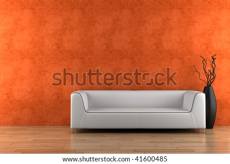 white sofa and vase with dry wood in front of orange wall - stock photo