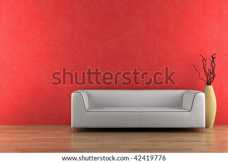 white sofa and vase with dry wood in front of red wall - stock photo
